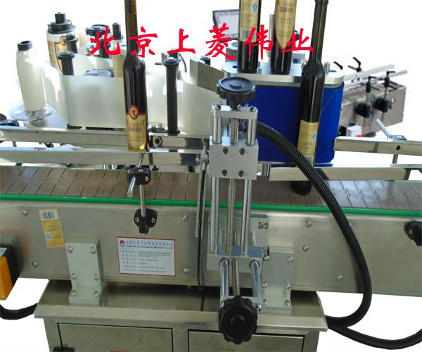 北京上菱伟业(图)_模内贴标机械_模内贴标机